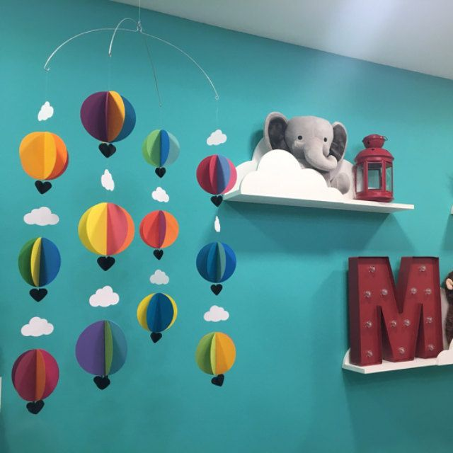 younghearts  |  I just love seeing my hot air balloon mobile in this nursery. Such a happy space :)