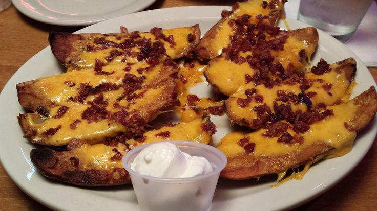 TATER SKINS  Texas Roadhouse Restaurant Copycat Recipe   Makes 6-10 servings   8 large baking potatoes  1/2 cup butter, melted  1/2 tea...