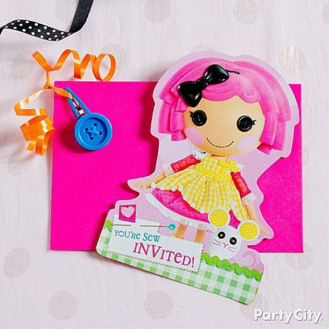A simple way to dress up a Lalaloopsy party invitation: Punch a hole in the corner of the envelope and tie on a hair clip with ribbon. Easy-peasy!