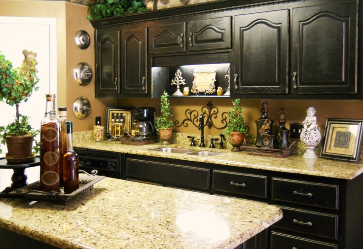 Love the black cabinets and the granite countertops for Countertop decor ideas