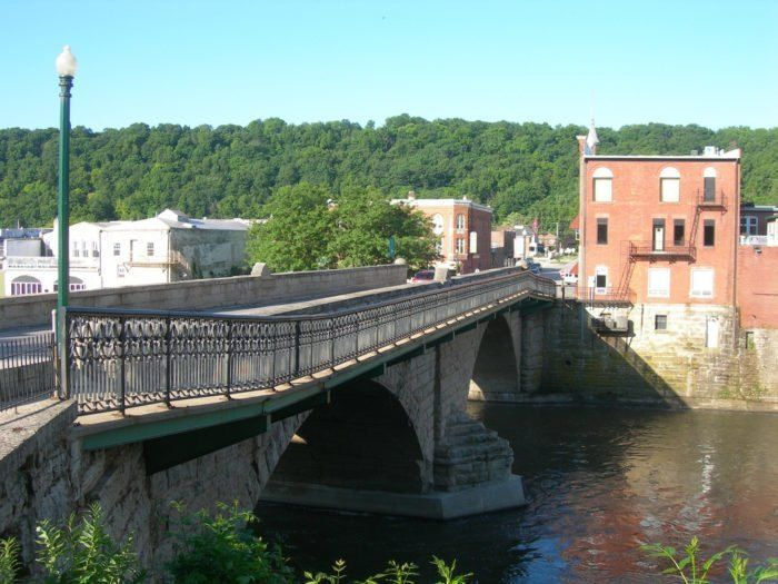 The Charming Town Of Elkader Offers A Unique Downtown Along The Turkey River In 2020 Iowa Road Trip Iowa Travel Places