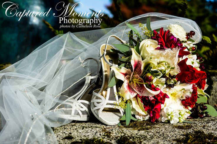Love this shot of the veil, shoes, and bride's bouquet! Beautiful wedding photography!