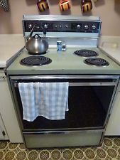 nice old stove, with tea towel and hob kettle