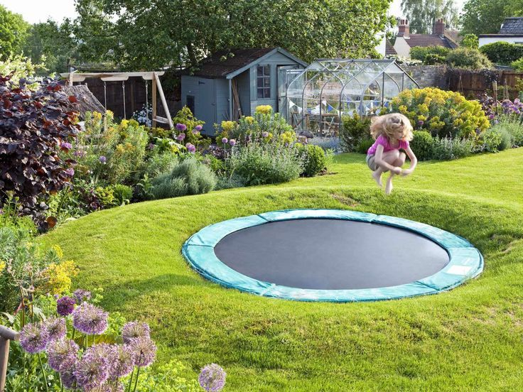 Now here is a great idea for any proud dad to implement. This sunken trampoline - part of a Family Garden Design - is a lot safer than having it a few feet above the ground.
