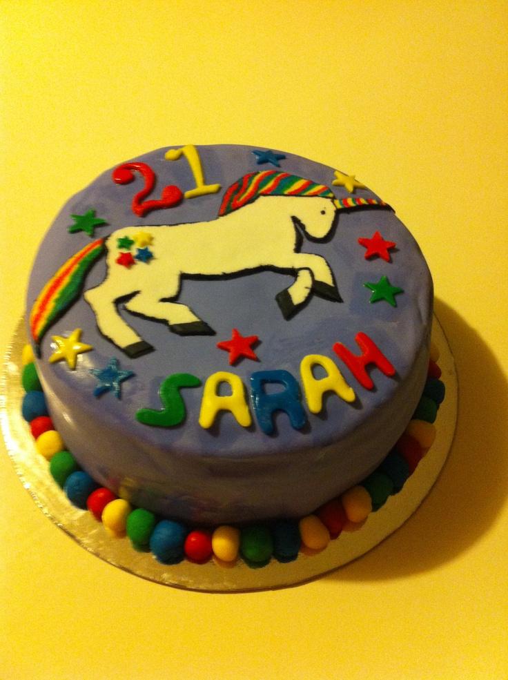 Hand painted Unicorn cake with rainbow layer vanilla cake