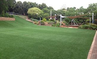 School playground created by Turf Green with synthetic grass that withstands wear and tear far better than natural turf. Artificial grass is also known as synthetic turf, synthetic grass, fake grass, fake turf, artificial turf, astro turf, artificial lawn, synthetic lawn