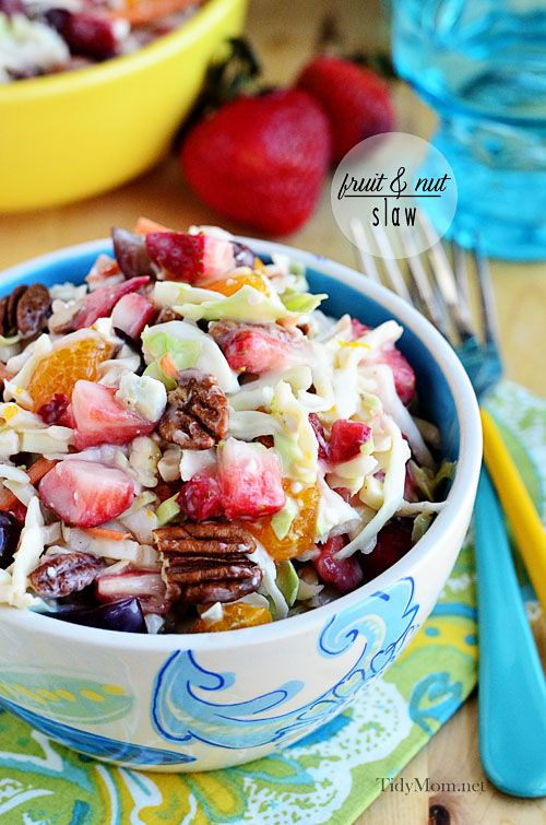 Strawberries and mandarin oranges, dressed in a light slaw dressing with pecans and blue cheese, this fruit and nut slaw is a great summer side dish. Print the full recipe at TidyMom.net