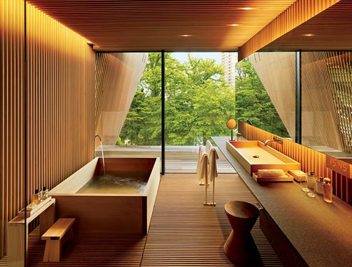 Japanese Bathroom design focuses on large window creating lots of natural light. beautiful and efficient