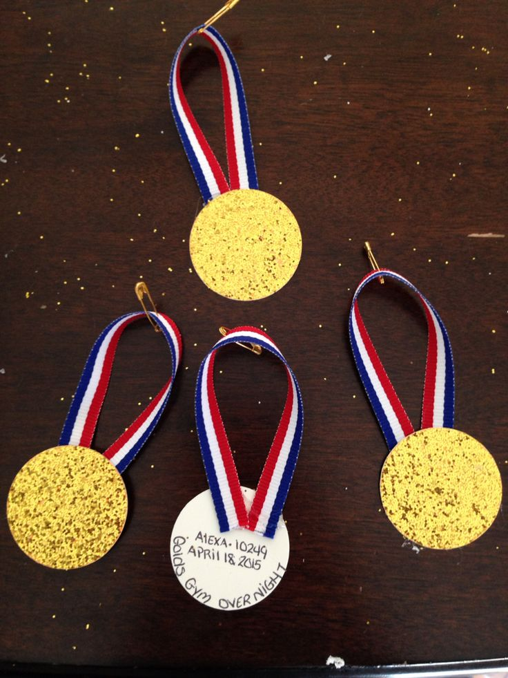 """Girl Scout SWAPS: gold medal swaps for our Olympic themed """"going for the gold"""" overnight trip to Golds Gym... I used gold glittered card stock and hot glued red white and blue ribbon add a pin & done!!"""