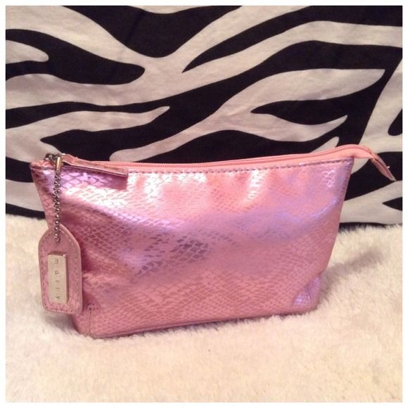 "Mally Cosmetic Bag Pink & Silver Snakeskin PERFECT Made by: Mally  Pink and Silver Snakeskin Look with original Mally (detachable) Logo Tab. Quality Made Bag with 8"" Zipper and Fully lined. Measurements: 4""Tall x 8""Wide x 2""Thick. Used once... Clean and in Excellent Condition! Thank you for browsing my Closet. Mally Bags Cosmetic Bags & Cases"