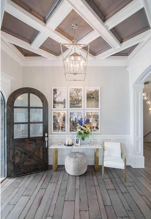 Foyer. Foyer entryway. Foyer with lantern pendant, plank hardwood floors, custom ceiling treatment and arched front door. #Foyer Joe Carrick Design.