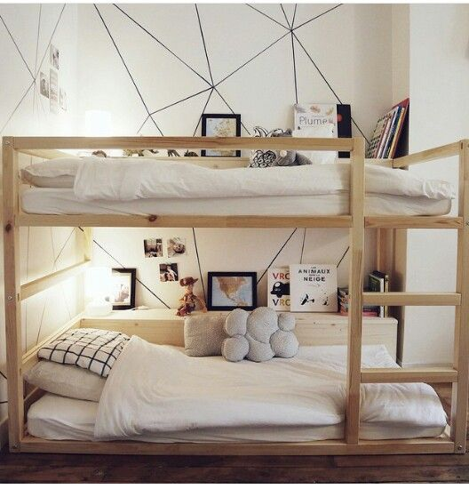 ikea kura bed transformed into bunk beds with shelves love that geometric wall all you need is a sharpie and a yardstick zie ook de ombouw achter het