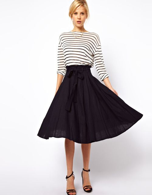 Love this entire look from ASOS. The skirt is available in navy and black. Ive ordered it in blacklove it with stripes, a white boatneck, a graphic TSo versatile.