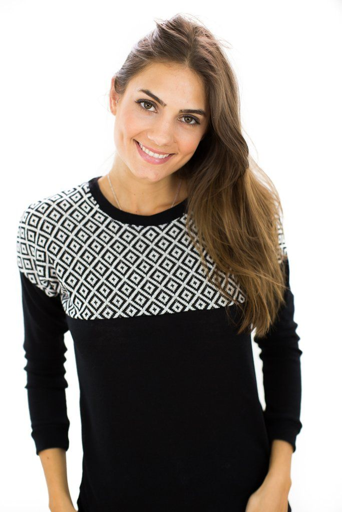 Sweater Phoria Black This elegant sweater is going to be your new wardrobe favorite. The lower part is made of a black knit fabric and the upper part of a white and black-colored knitted fabric with diamond pattern. http://shoko-shop.com/collections/new-in/products/sweater-phoria-black-1