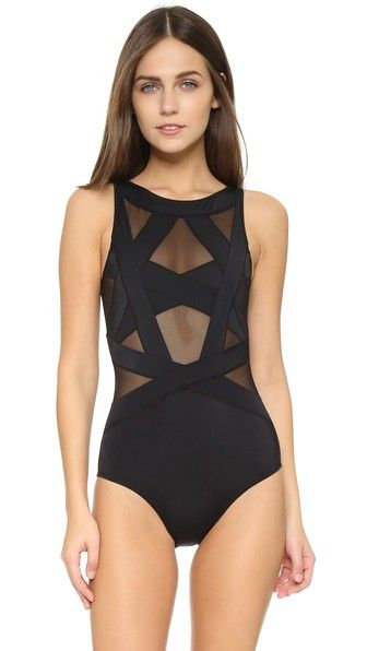 Black OYE Swimwear  swimsuit  for woman This OYE Swimwear swimsuit is detailed with geometric straps backed by sheer mesh. Double layered. 80% polyamide/20% lycra spandex. Hand wash. Imported, Turkey. Size & Fit. Available sizes: L,M,S,XS #bathingsuit