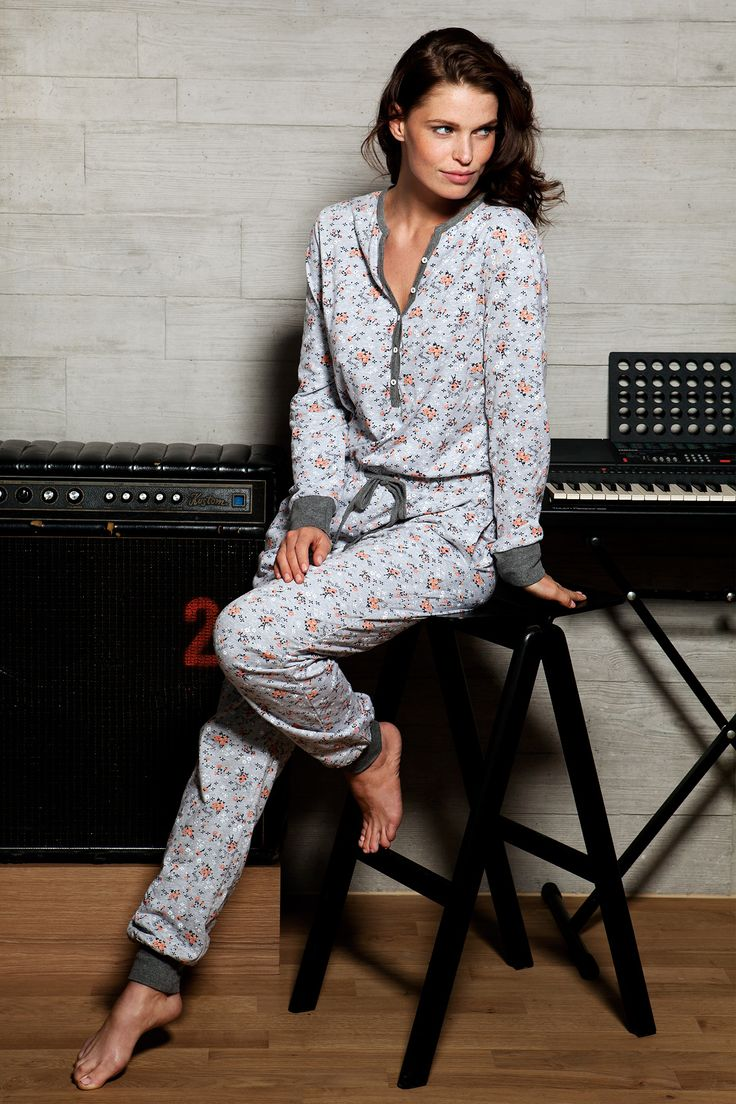 A young & trendy all-in one light grey jumpsuit with a pretty orange floral design - Be young and fresh and in style with Rebelle!