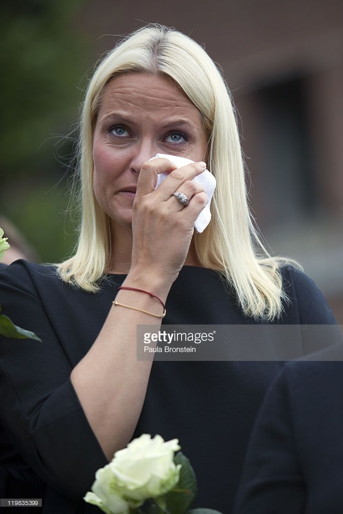 Crown Princess Mette-Marit of Norway cries as thousands of people gather at a memorial vigil following Friday's twin extremist attacks on July 25 ,2011 in Oslo, Norway. Anders Behring Breivik, 32, claimed that he has 'two more cells' working with him as he appeared in court today following a bomb blast at a government building in Oslo and a shooting massacre on nearby Utoya Island that killed at least 76 people in all. The death toll was originally reported as 93. Breivik has been detained…
