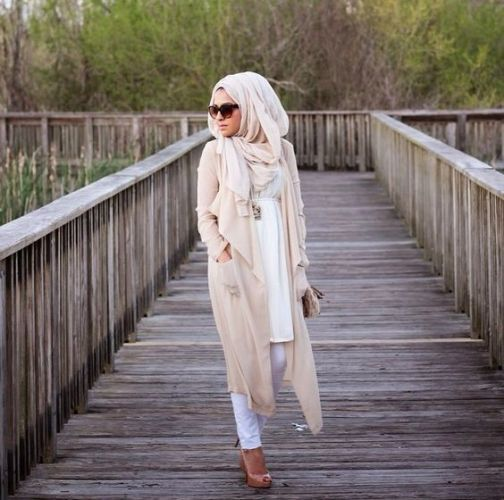 neutral long cardigan with pastel blouse