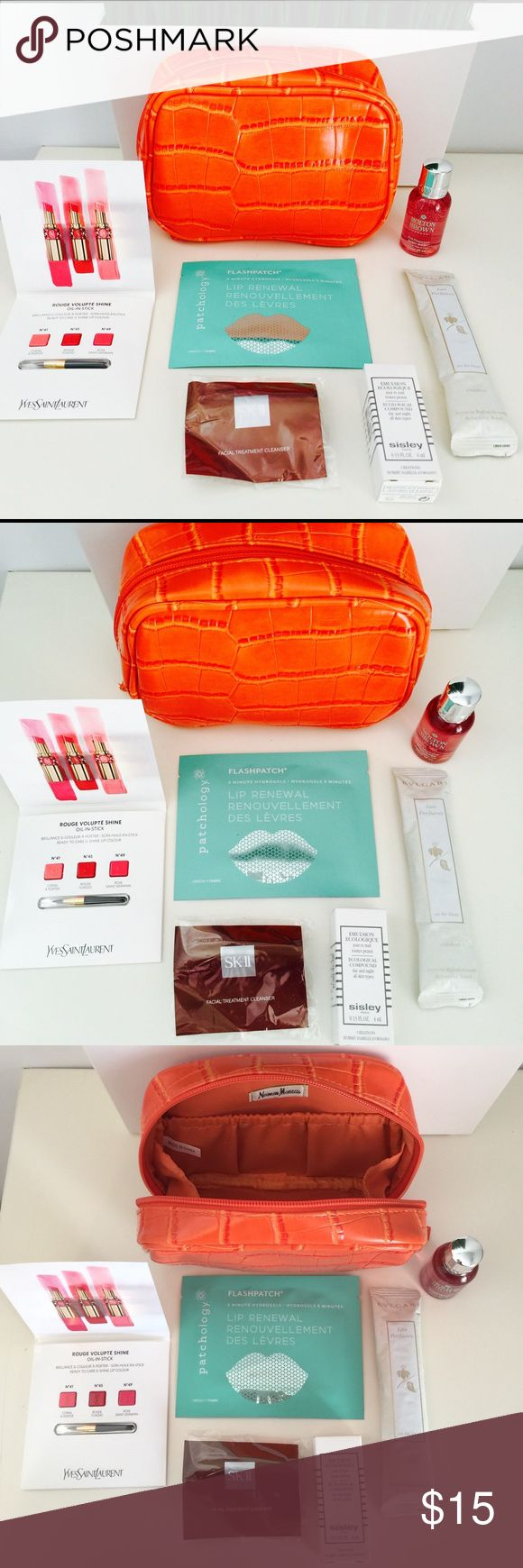 Neiman Marcus Orange Beauty/Cosmetic Makeup Bag New lower price & more new samples!! Autumn perfect beauty (cosmetic/makeup) bag. A good fit for all your beauty essentials. Comes with the beauty samples seen in pictures and more! New & Unused samples included: Giogio Armani fluid sheer, Clarins Beauty Flash Balm, Boss Intense Eau de Toilette, Sisley Ecological Compound, SK-II facial Cleanser, BVLGARI refreshing towel, YSL lipstick sample, Molton Brown body wash & Flashpatch lip hydrogel…