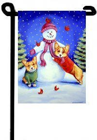 "Cardigan Corgi Christmas - Garden Flags by Flagline. $16.75. 11"" x 15"". The Garden size flag is made from a 100% polyester material. Two pieces of material have been sewn together to form a double sided flag. This allows the text and image to be seen the same from both sides. This flag is fade resistant and weather proof. The flag measures approximately 11 inches x 15 inches (garden stand sold separately).  This is a new item, and can take from 10-14 days to ship."