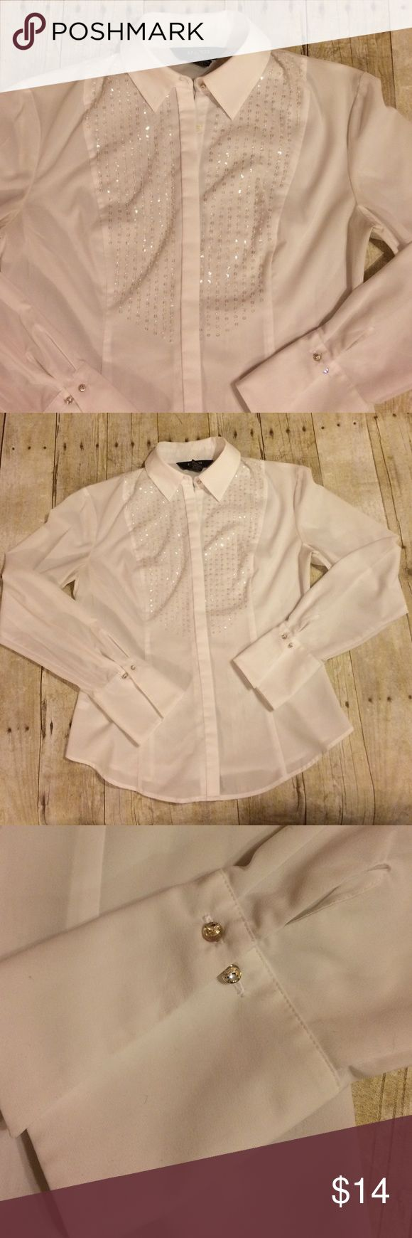 Express white shirt Express white shirt, sleeves with cufflinks. Perfect for work or for a party. It also looks great with cute jeans. I bought it but it no longer fits. In great condition. Stretch fabric, 96% polyester , 4% spandex. Sz is 3/4 which is basically a small. Express Tops Button Down Shirts