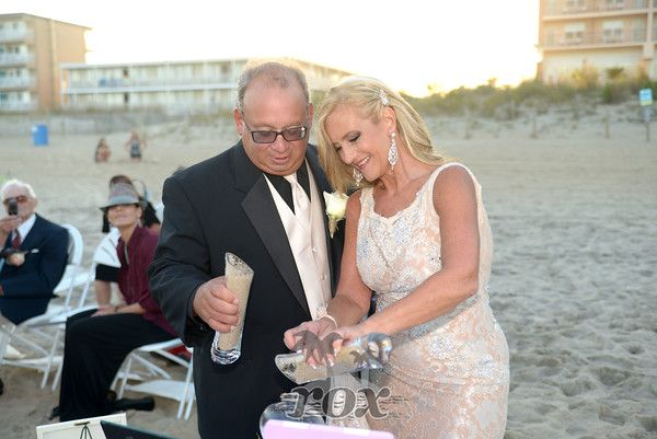 Sand Unity Ceremony during a beach wedding in Ocean City, MD:  https://www.roxbeachweddings.com/
