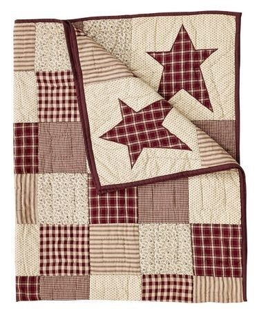 Enjoy our exclusive Cheston primitive star quilted throw. This custom design can only be found at Primitive Star Quilt Shop.
