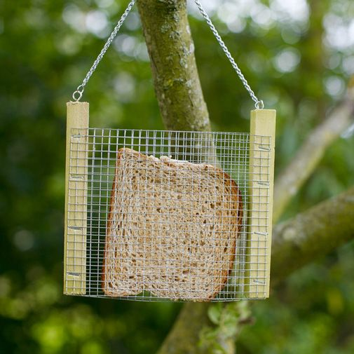 Bird Bread Feeder - Use a suet basket/holder. This is fantastic! Pop your stale bread and burnt or leftover toast into the slice-shaped slot, hang it outside and feed the hungry birds.