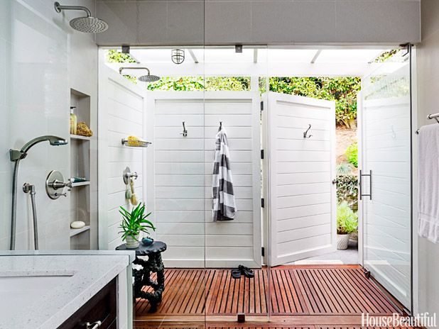 indoor/outdoor shower---a large section of the glass wall pivots to allow outdoor bathing on a whim.  additionally, the exterior shower can be accessed from the yard (as demonstrated).  I love the picturesque beauty of this wide-open space!