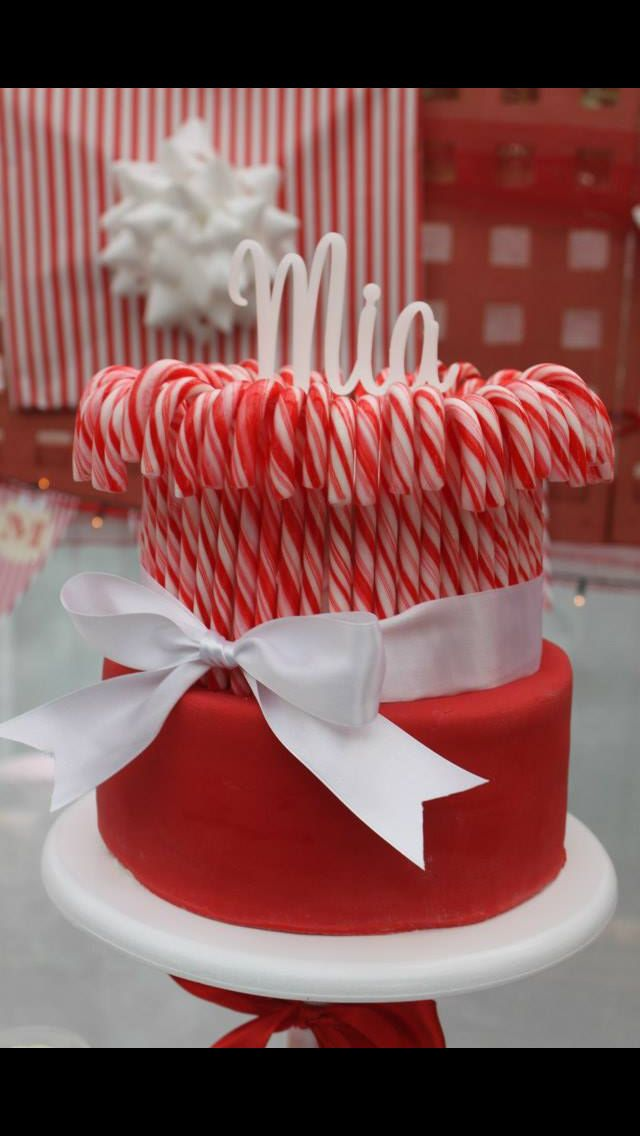 The birthday cake - 2 tier milk chocolate mud cake with dark chocolate ganache, covered in fondant and candy canes