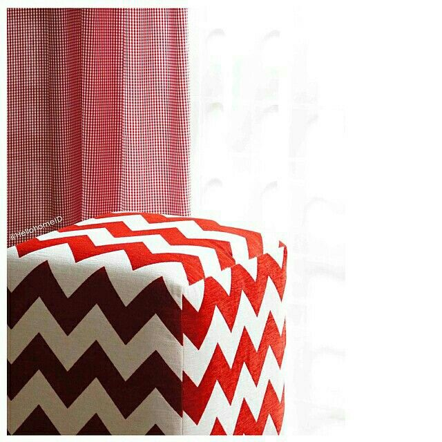 Red curtain and red pouff to brighthen your house.