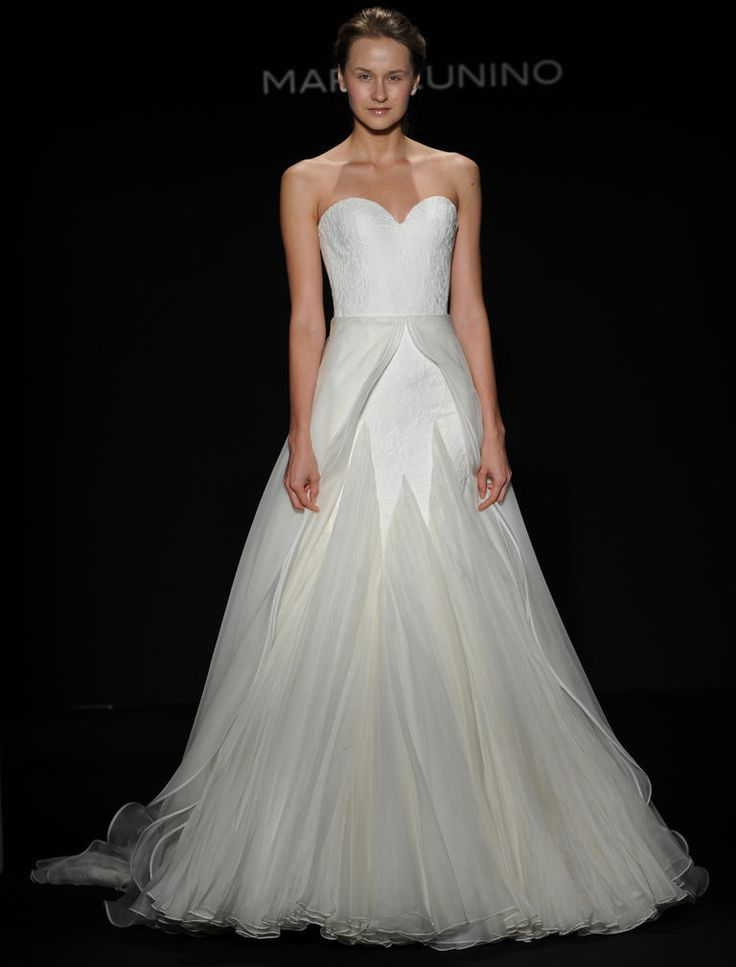 Mark Zunino Fall 2016 moire patterned chantilly lace over crepe wedding dress with organza layered flounce and beaded feather applique | https://www.theknot.com/content/mark-zunino-wedding-dresses-bridal-fashion-week-fall-2016