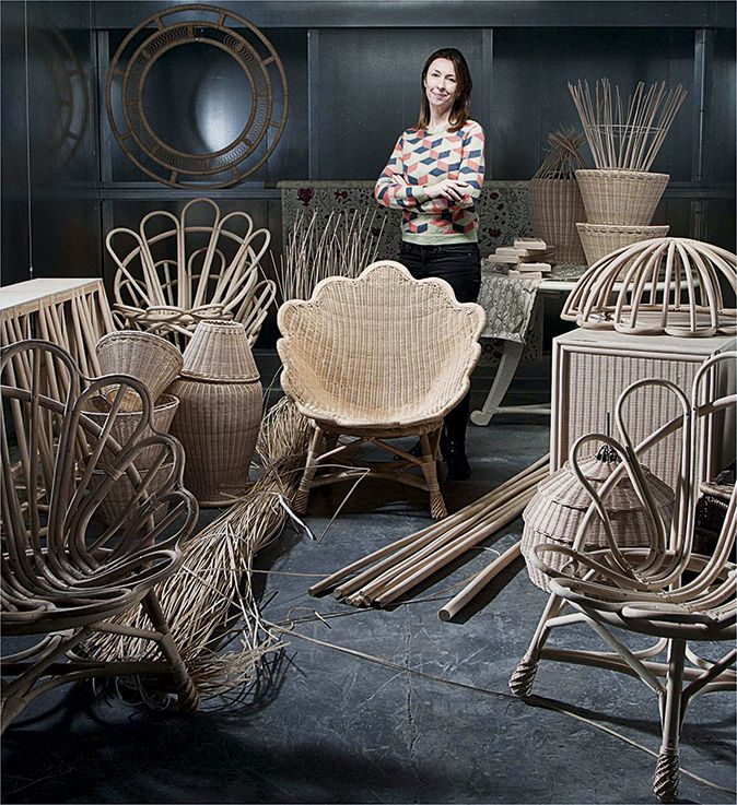 Lulu Lytle of Soane Britain photographed with Soane rattan designs manufactured in Britain's last surviving rattan workshop. (Country Life magazine)