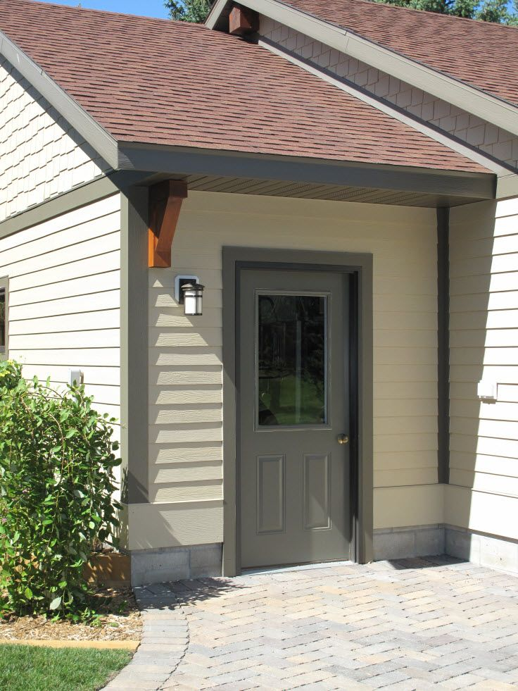 Exterior doors steel garage door painted grey with light yellow siding bayer built woodworks for Exterior garage doors