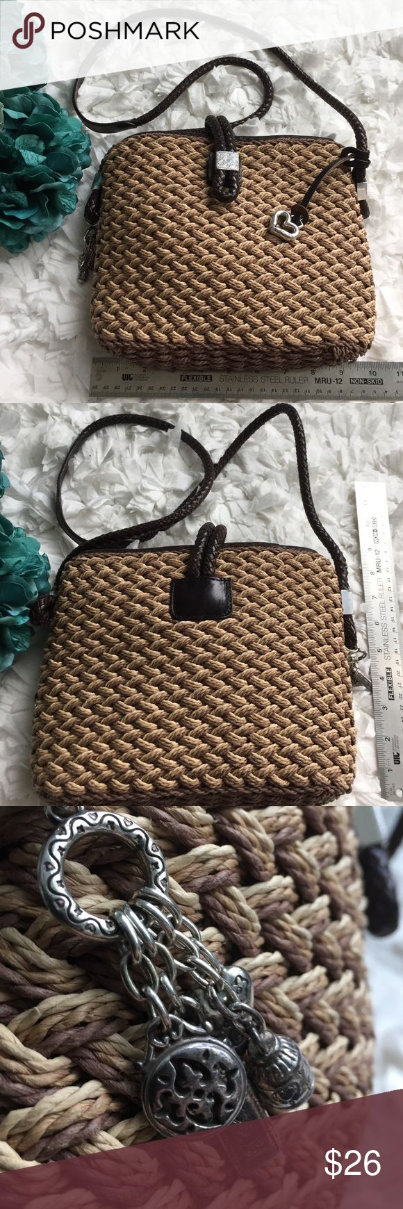 Brighton straw and leather purse w/darling lining Super cute Brighton purse in like new conditions. Trademark Brighton details w/charms and heart.  See close up to show woven detail. Brighton Bags Shoulder Bags