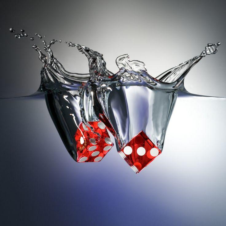 Dice Sploosh by David Harpe, High speed macro photograph of two Las Vegas regulation dice splashing into water.
