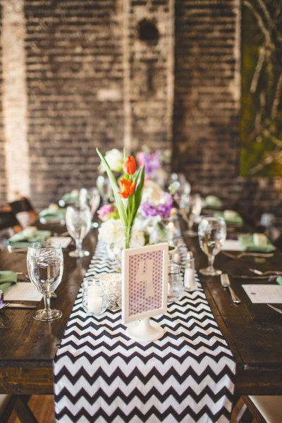 modern loft backdrop and lots of color and chevron \ Photography by michaelmoss.com |  Design + Planning by eventsbylafete.com |  Floral Design by freshaffairs.com |   Read more - http://www.stylemepretty.com/2013/07/16/raleigh-wedding-from-events-by-la-fete-michael-moss-photography/