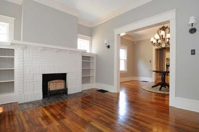 Craftsman interior- love the hardwoods, wall color, molding. What did I say when you have a fireplace in the middle of the wall?!
