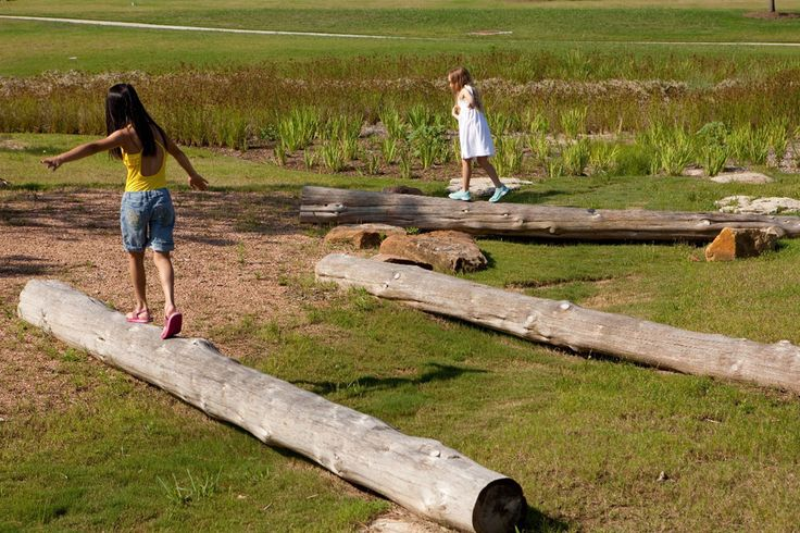 Unstructured play focused on organic elements like boulders and logs  Promotes interaction with nature