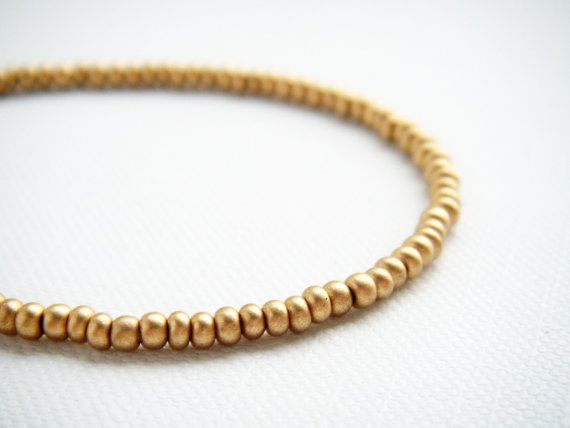 Gold satine tiny beaded bracelet friendship by juditpukkai Use coupon code on Etsy: PIN10 to get 10% discount :-)