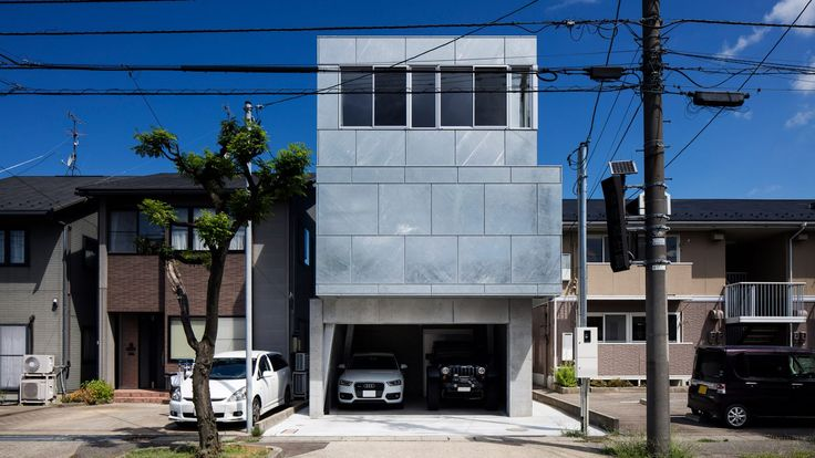 Galvanised steel panels cover irregularly stacked volumes of Japanese townhouse