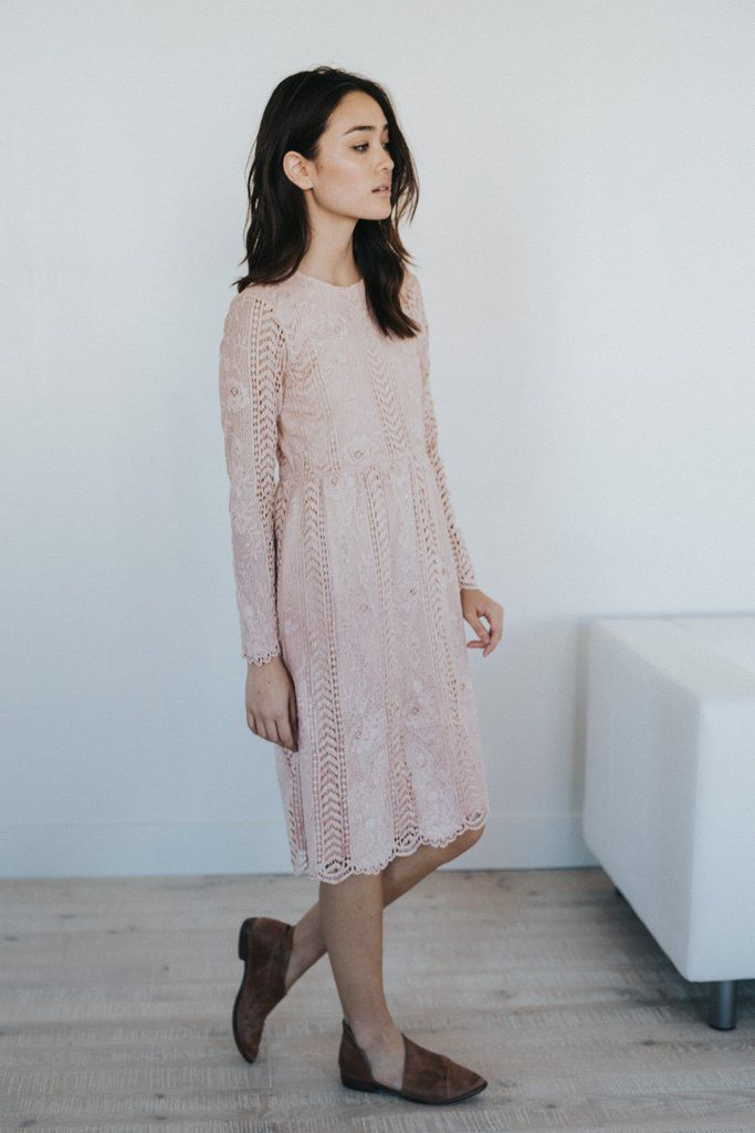 DETAILS: Elegant long sleeve lace a line dress with cinched waist Scalloped hem Keyhole back Fits true to size Model...