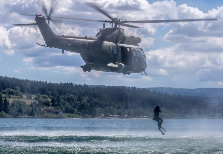 Divers of French 13th Engineer Regiment jump from a Puma helicopter from the 3rd RHC, during an anti mining exercise. July 21 to 23, 2015. - J.Hubert / Armée de Terre.
