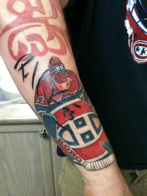 Tattoo of Patrick Roy. Dude got Roy to sign it, then had it tattooed onto him, too. THAT's what I call a fan!