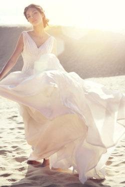 She dances on the beach like nobody is watching.