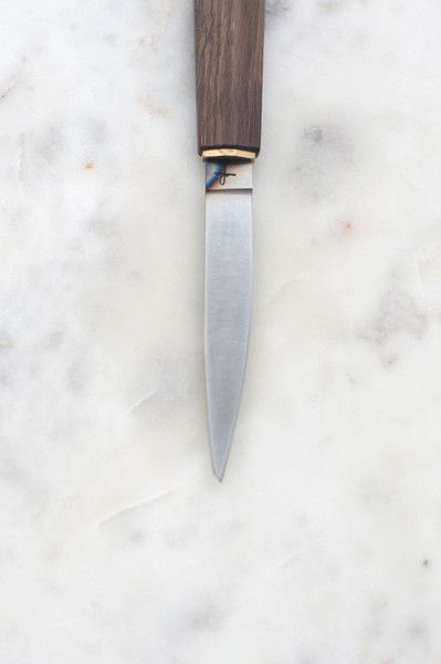 The Hohenmoorer YO Monostahl Paring Knife is a small, modern paring knife.