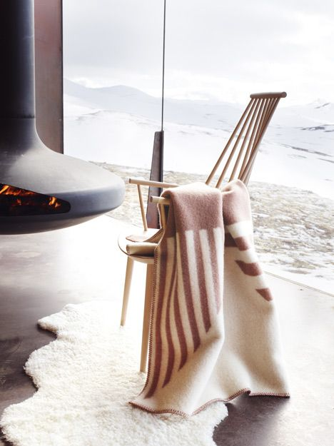Loving the fire place and the blanket by Snøhetta for Røros Tweed