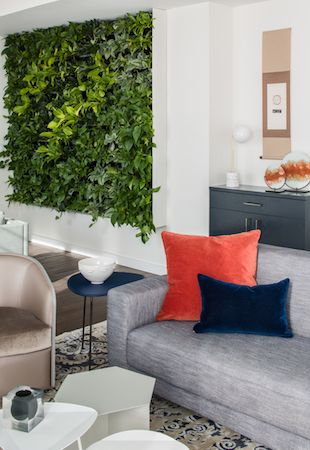 A living plant wall sits adjacent to the foyer of this penthouse.