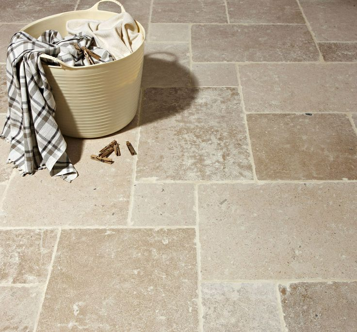 Classic French Burgundy tumbled limestone flooring. Mandarin Stone.