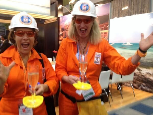 Women at Work | Tourism Indaba 2014 | Barbara and Sally 'digging' the champagne  http://www.capepointroute.co.za/